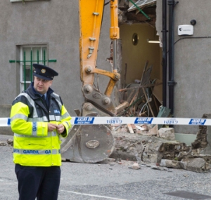 JCB left after smashing hole in post office wall