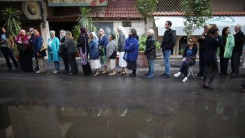 Voters queue at a polling station in the wealthy Cairo suburb of Zamalak