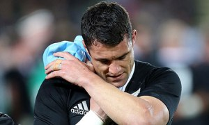 Daniel Carter of New Zealand walks off injured