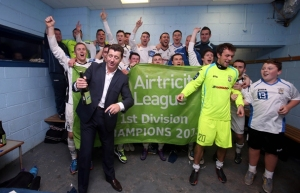 Roddy Collins and The Athlone team celebrate in the dressing room after the game 27/9/2013