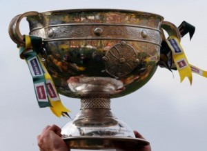the-sam-maguire-trophy-is-raised-2-390x285
