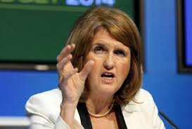 Joan Burton demonstrates her own new phone (image: Independent.ie)